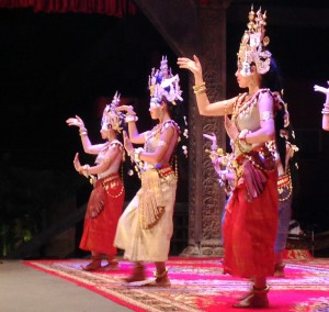 Apsara dancers. When an apsara depicted is in front of a temple in a still position, then it is called a devata.