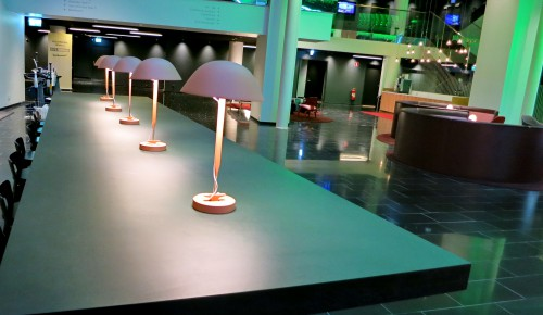 I like the pink lamps on this black table.