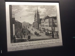 The street, from the Holy Cross Church and up to Staszic Palace, where the monument of Copernicus stands now stands. I took a photo of this illustration at Chopin Museum.